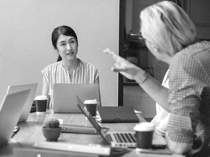 Woman at computer in meeting